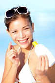 Vacation woman putting sunscreen