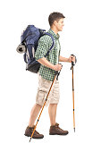 Hker with backpack and hiking poles walking