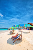 White Sandy Beach with Chairs and Umbrellas