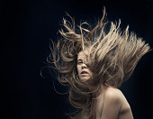 young beautiful women with flying hair