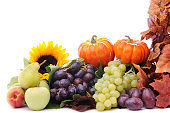 Pumpkins and fruits with maple leaves
