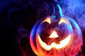 Halloween pumpkin with colorful smoke