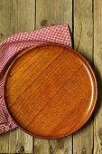 empty wooden plate on the old table