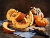 Fresh pumpkins on wooden table