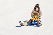 Mother and child tobogganing