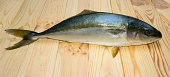 yellowtail fish on wooden boards