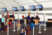Lining up at check-in counter in the airport