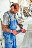 Male Worker on Marble or Granite Bevel