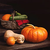 Arrangement with pumpkins and autumn leaves