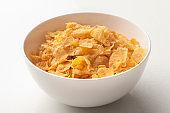 Corn flakes in a white bowl