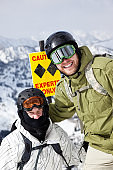 Snowboarders Wearing Sunglasses and Helmet in Expert Trail