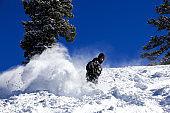 Snowboarder in action in Powder Snow