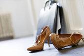 High Heels And Briefcase On Floor