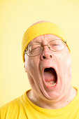 funny man yawning portrait real people high definition yellow ba