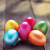 Colorful Easter Eggs on rustic wood