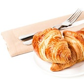 Breakfast with  french croissants on a plate and linen tableclot