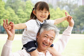 Chinese Grandfather Giving Granddaughter Ride On Shoulders In Pa