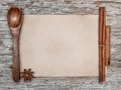 Sheet of paper, wooden spoon and spices