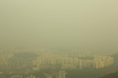 Aerial view of smoggy urban cityscape