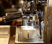 Close-up of espresso being made on barista machine