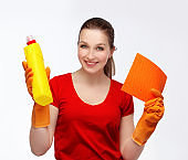 Young  woman holding cleaning equipment