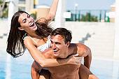 Couple having fun on the pool
