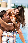 Couple having fun by the swimming pool