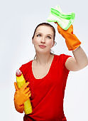 Female cleaner holding a sponge and cleaning product
