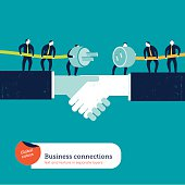 Businessmen with plug and socket on a handshake