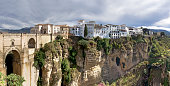 Ronda Village  suspension bridge, white houses perched on the ro