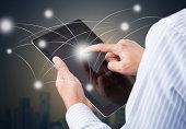 Businessman holding tablet touchscreen