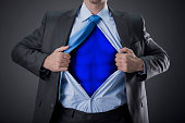 businessman as super hero and tearing his shirt