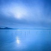 Water surface,  blue morning on the Trasimeno lake, Italy. Hi