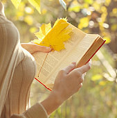 Autumn season, people and reading concept