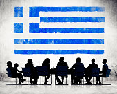 Silhouette of Business People and a Flag of Greece