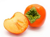 Orange ripe persimmon isolated on white