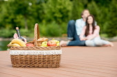 Picnic basket with wine and fruits
