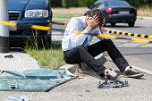 Sad man at accident scene