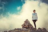 Woman Traveler on Mountain Summit