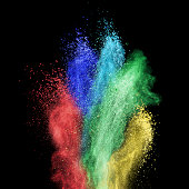 Color powder explosion isolated on black