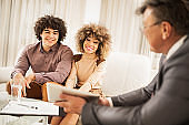 Couple on a meeting with real estate agent.