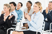 Group Of Businesspeople Clapping In Seminar