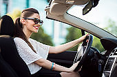 gorgeous woman driving a convertible car