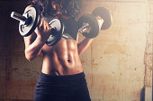Crossfit woman with dumbbells