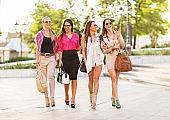 Young women walking in the street.
