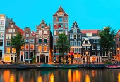 Night Amsterdam canals and typical houses, Holland, Netherlands