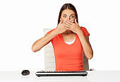 Shocked Woman With Hands Covering Mouth - Isolated