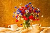 Still life bouquet camomiles cornflowers poppies