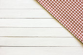 Checkered Tablecloth On The White Wooden Background.