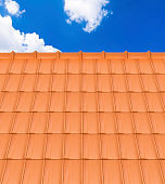Red Roof Tile Pattern and Blue Sky
